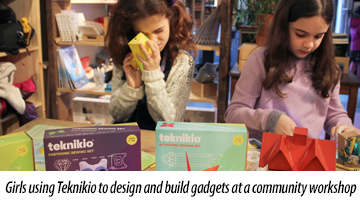 Girls using Teknikio to design and build gadgets at a community workshop